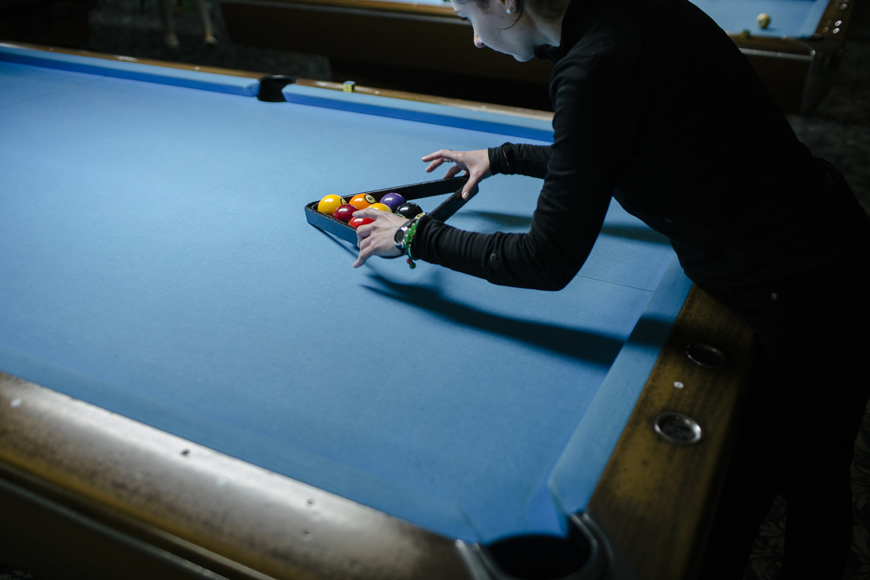 Soldiers play pool and then rack each others balls