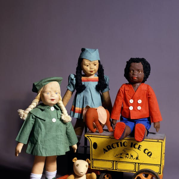 "Three 22"" American dolls and two cloth counterpane toys made by the WPA Milwaukee Handicraft Project."