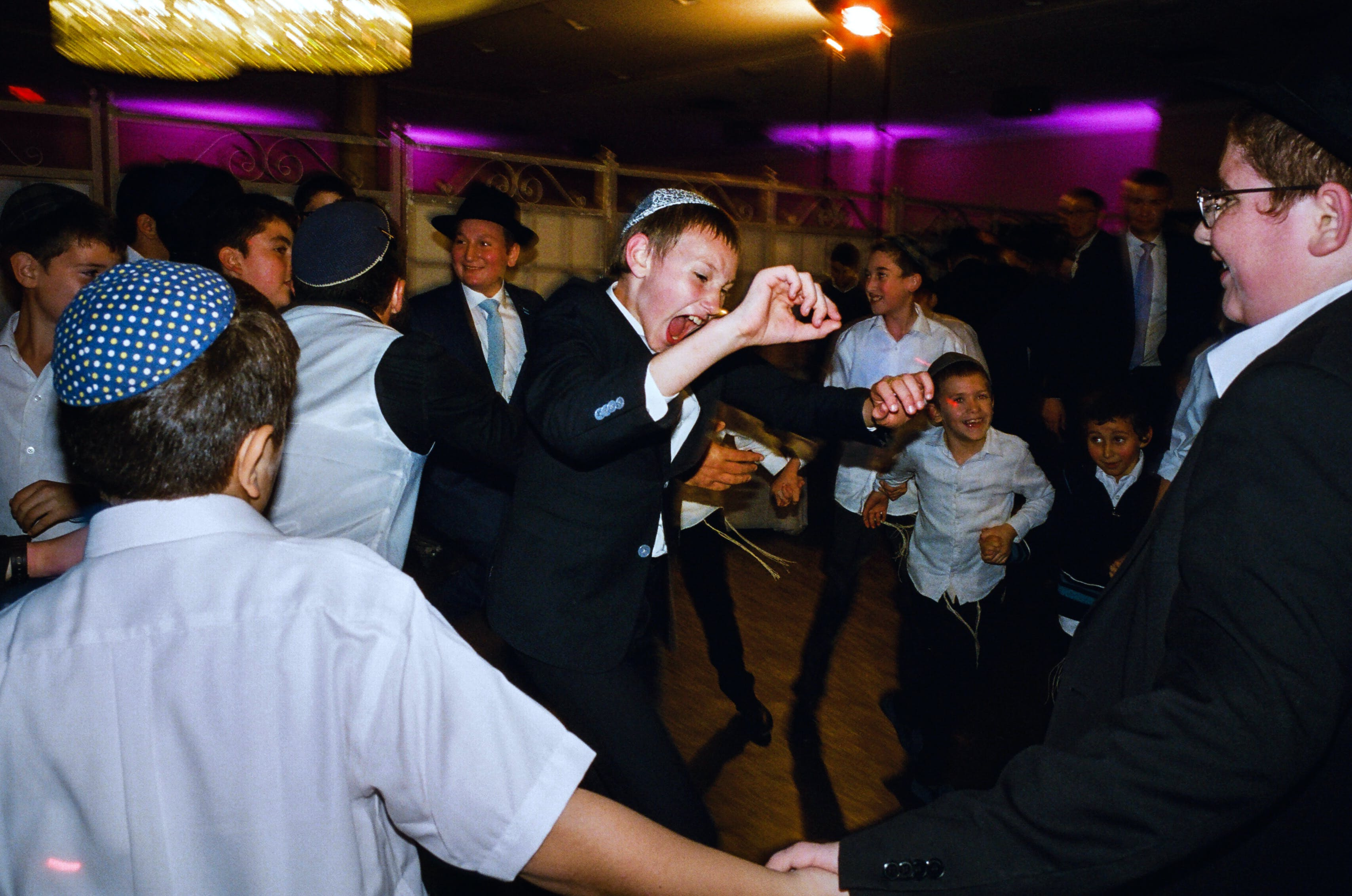 The bar mitzvah boy's brother rivals Meir Kay with his unstoppable energy.
