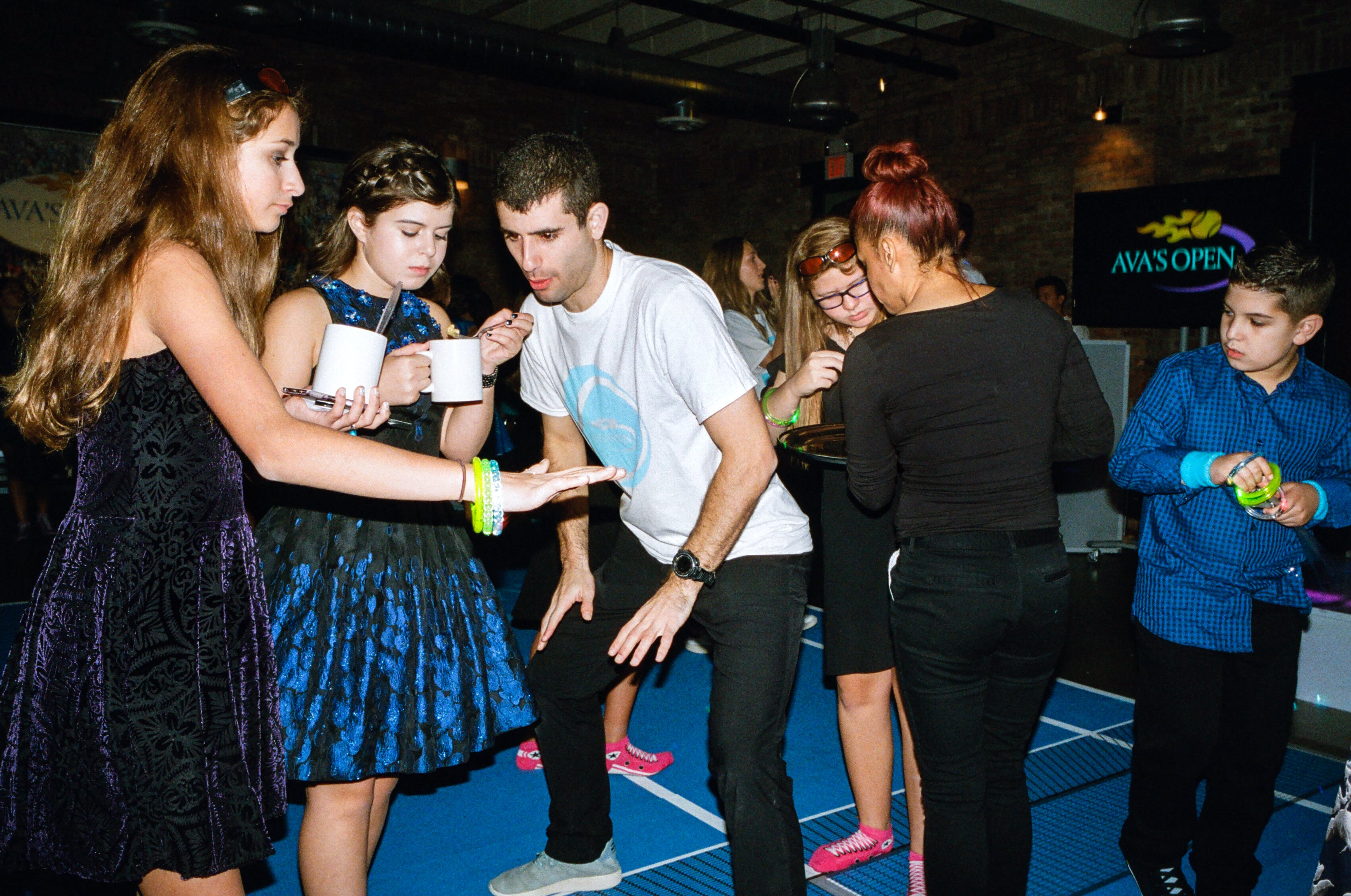 It's incredibly charming to see how the entertainers check in with and take cues from the kids on the dance floor.
