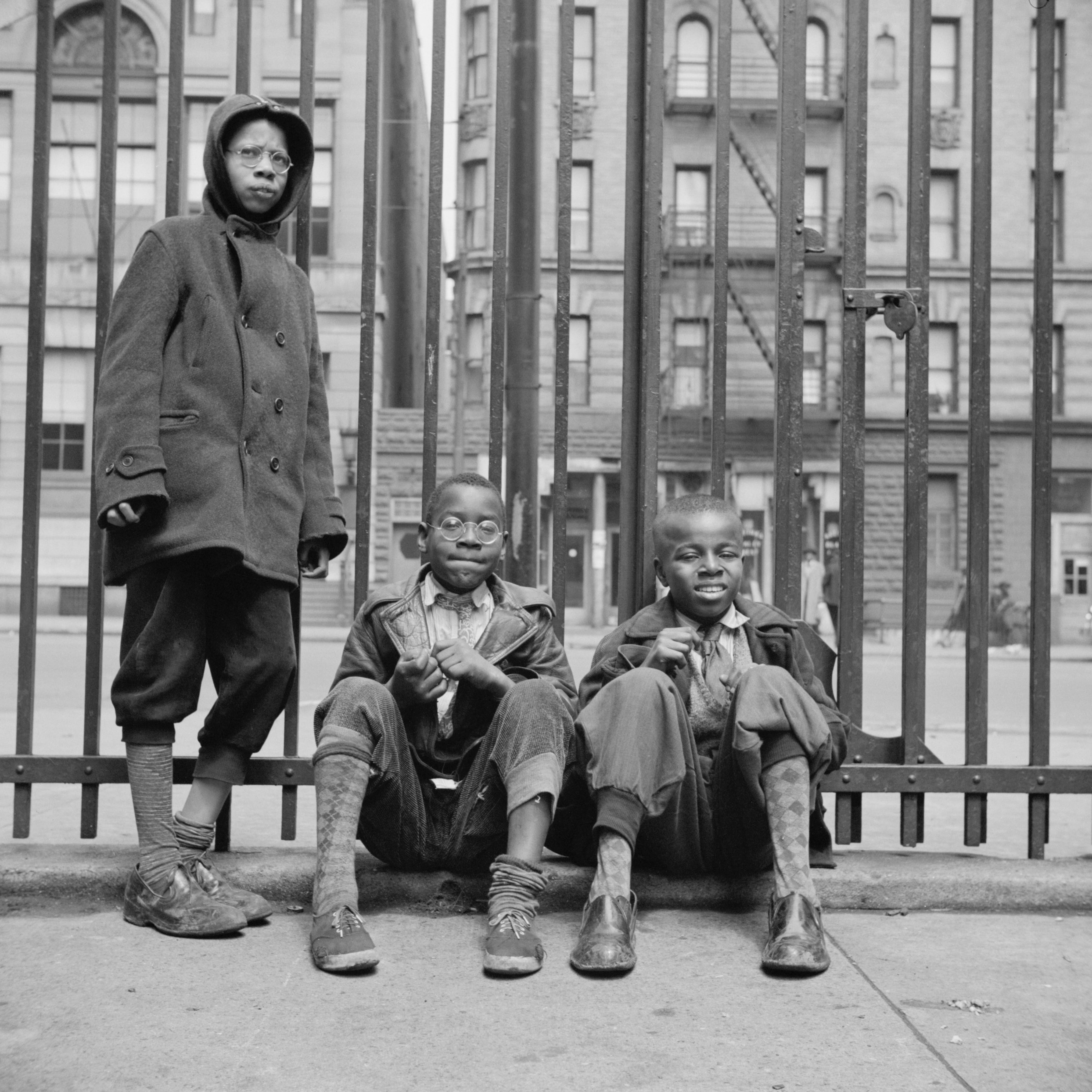 Three boys who live in Harlem, 1943.