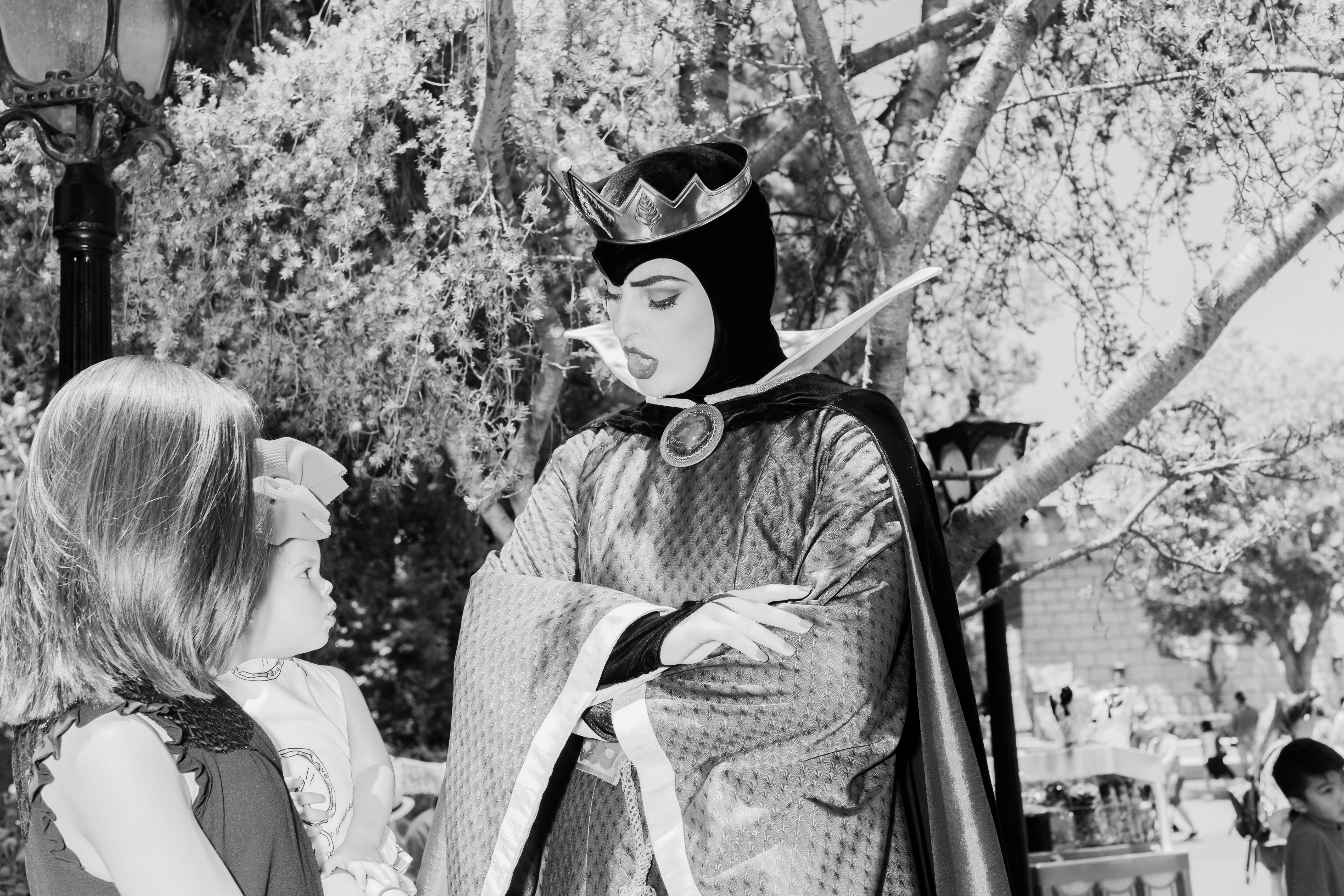 A cast member dressed as the Evil Queen from Snow White.
