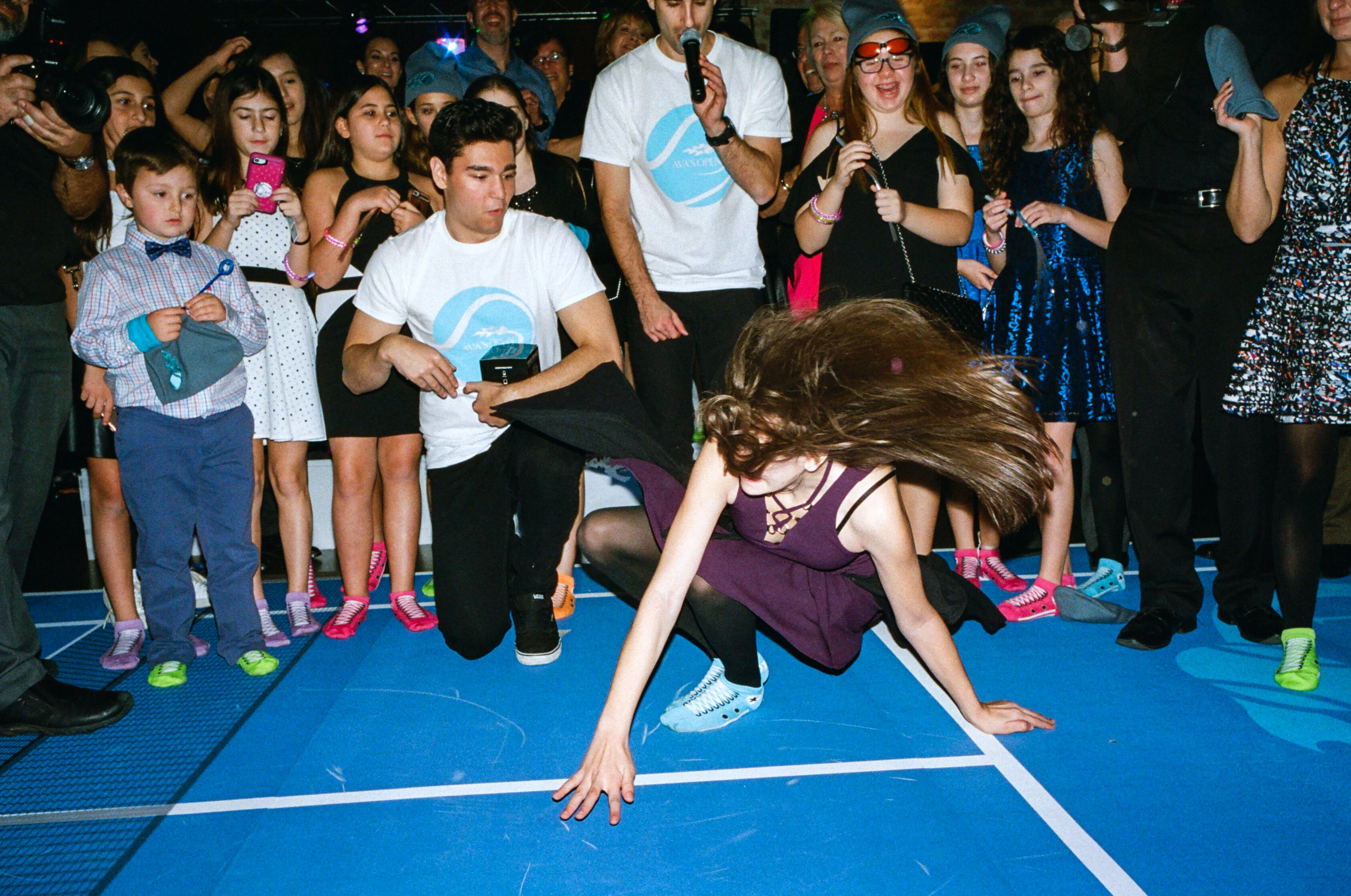 DJ Zap crowds the floor with an impromptu-feeling dance battle.
